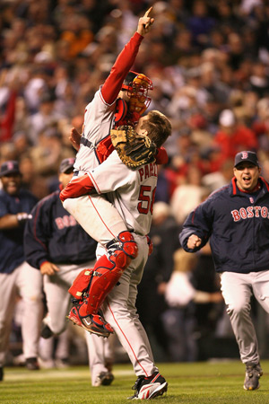 Red Sox players Jonathan Papelbon and Jason Varitek celebrate their World Series win.