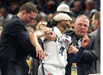 <br>Allan Ray is helped off the court <br /> Click image to expand.