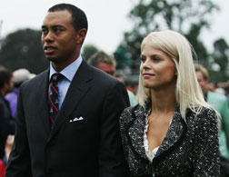 Tiger Woods and his wife Elin. Click image to expand.
