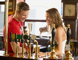 Couple talking at a bar. Click image to expand.