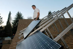 Phil Tussing installing  Phil Tussing installs photovoltaic solar panels. Click image to epxand.