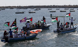 Palestinians ride on boats at the port of Gaza City during a rally in support of the Gaza-bound international Freedom Flotilla. Click image to expand.